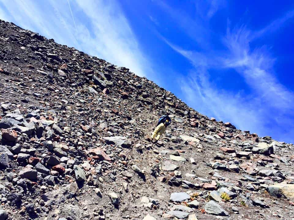 scrambling through shale up South Sister Oregon