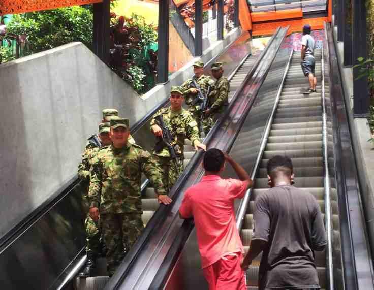 Policia on the escalators in Comuna 13