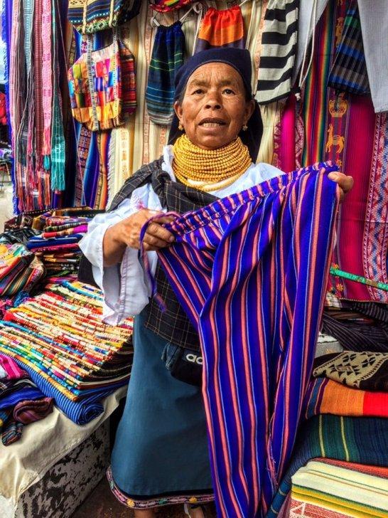 Vendor at Otavalo Market things to do in Ecuador
