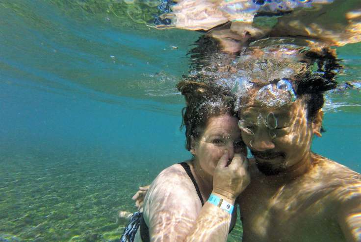 Swimming in crystal clear water from the Gruta da Pratinha