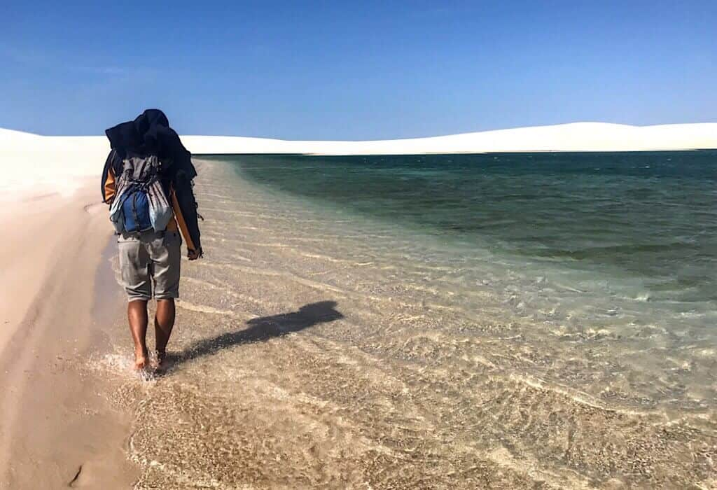 Trin walking along a sand pool in Lencois Maranhenses