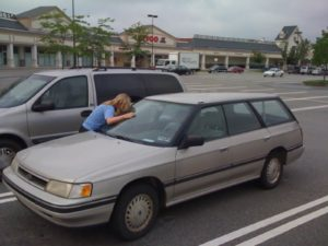 Saying goodbye to the Subaru Legacy in the REI parking lot.