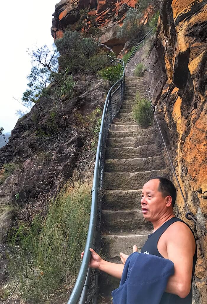 Terry on the stairs next to Wentworth Falls in the Blue Mountains of New South Wales, Australia