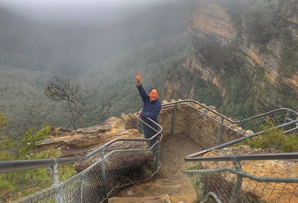 Terry happy and giving the peace sign at the three sisters outlook
