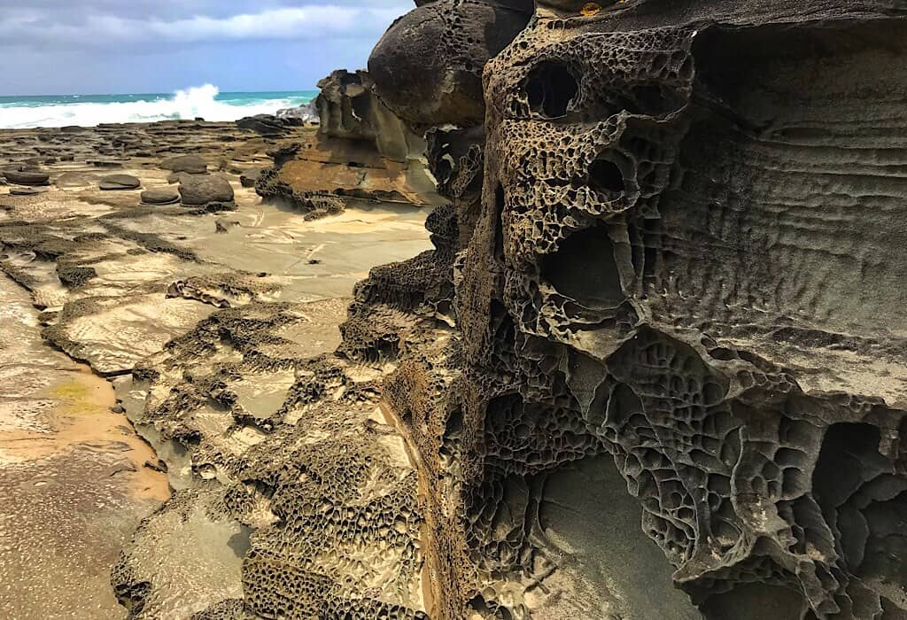 Rock formations where the Elliot River empties into the Ocean along The Great Ocean Road, Victoria, Australia