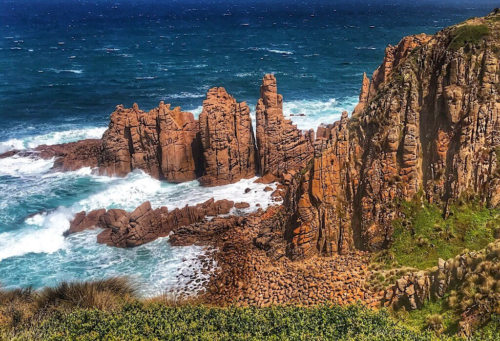 Large red rock formation at Cape Woolamai on Philip Island, Victoria, Australia