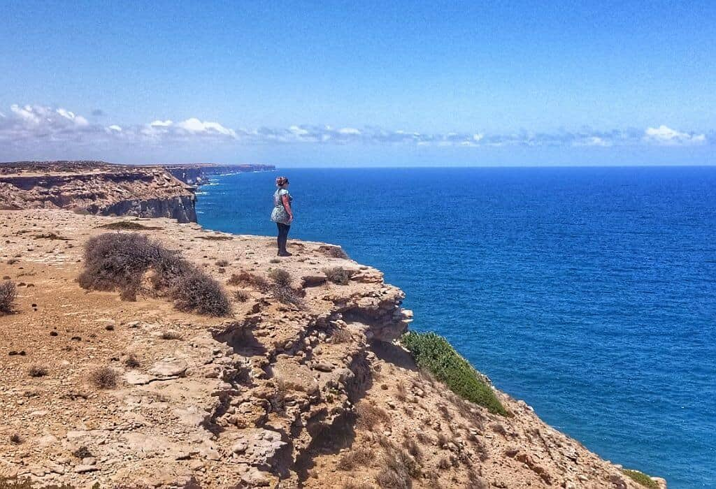 Bonnie standing on the edge of the Nullarbor looking over The Great Australian Bight