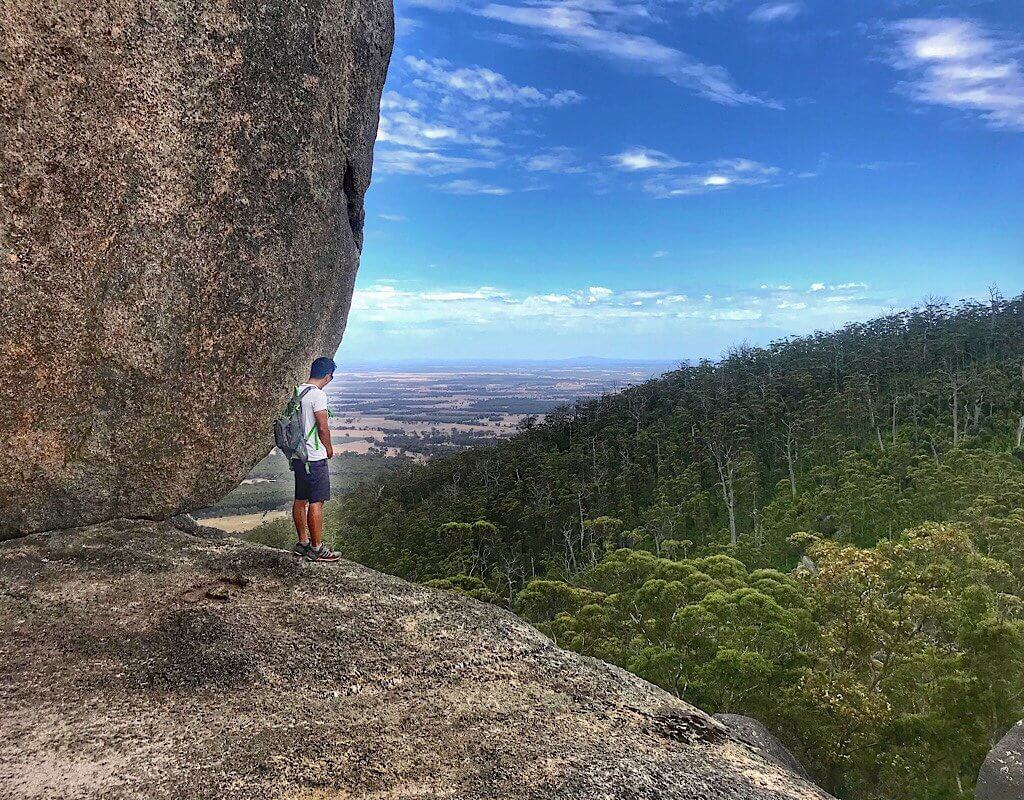 Trin standing on the edge of a granite boulder in Castle Rock Western Australia