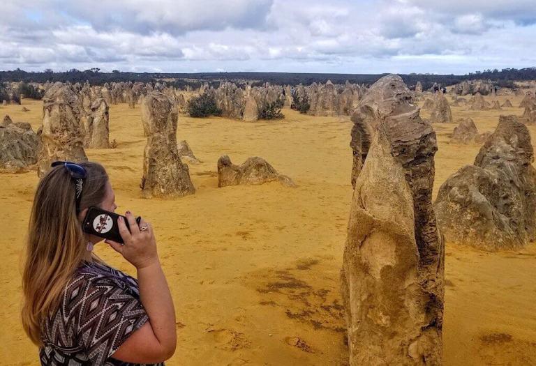 Bonnie on the cell phone at Pinnacles NP Western Australia