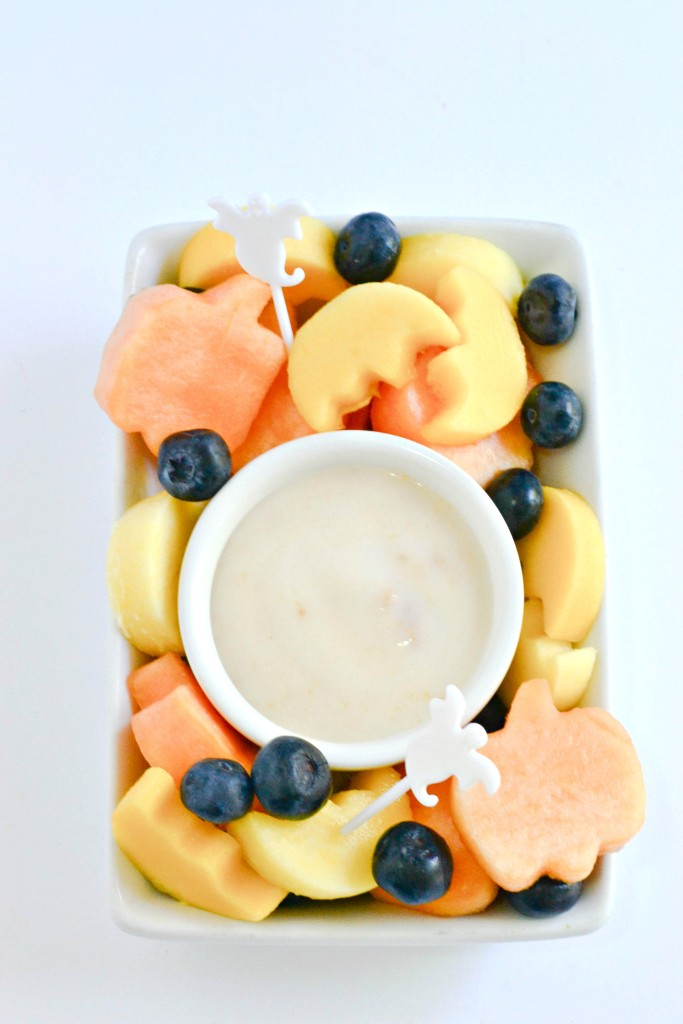 Halloween-shaped fruit with a coconut yogurt dip