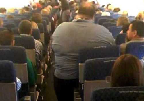 Passenger sues British Airways after he was made to seat near ?extremely large man?