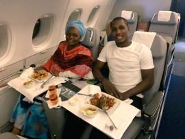 Super Eagles striker, Odion Ighalo shares rare photos with his mom inside a plane?