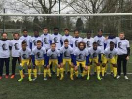 """The under-19s at FC Nantes pose for pictures - wearing t-shirts with the words """"We Love You Emi"""""""