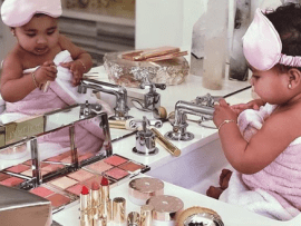 Catch them young! True Thompson plays with makeup in adorable new photos