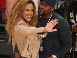 Floyd Mayweather cosies up to a stunning mystery lady at LA Lakers vs Minnesota Timberwolves clash at Staples Center (Photos)