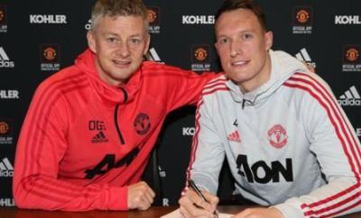 Manchester United interim manager Ole Gunnar Solskjaer and defender Phil Jones