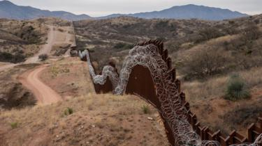 The US border fence, covered in concertina wire, separating the US and Mexico, at the outskirts of Nogales, Arizona, on February 9, 2019