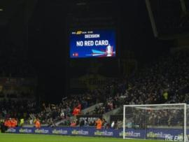 The big screen at Wolves versus Manchester United displays a VAR decision