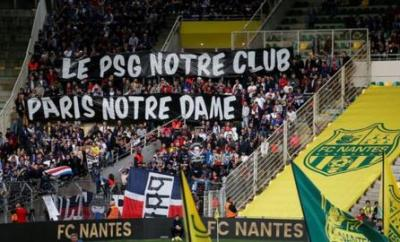 PSG fans held up a banner in honour of the Notre-Dame cathedral in Paris, which was severely damaged in a fire on Monday