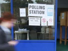 A girl walking past a polling station