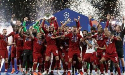 Jordan Henderson and Liverpool team-mates celebrate winning the Champions League