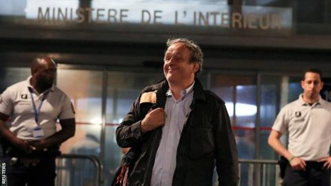 Michel Platini leaves a police station in Nanterre where he was questioned