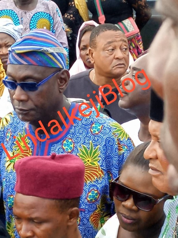 Adekunle Gold and wife Simi filmed paying their last respects as his father, Prince Hakeem Kosoko is laid to rest (photos/videos)