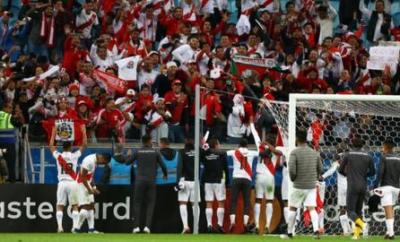 Peru celebrate with their fans at the final whistle