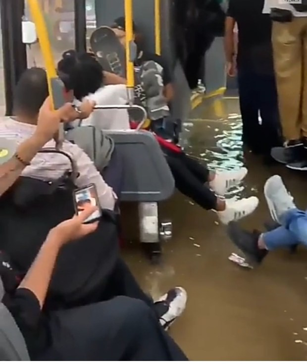 New York City bus passengers struggle to stay dry as their bus gets flooded due to rainy weather (video)
