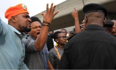 Photos: Armed police officers, soldiers clash with #RevolutionNow protesters in Lagos