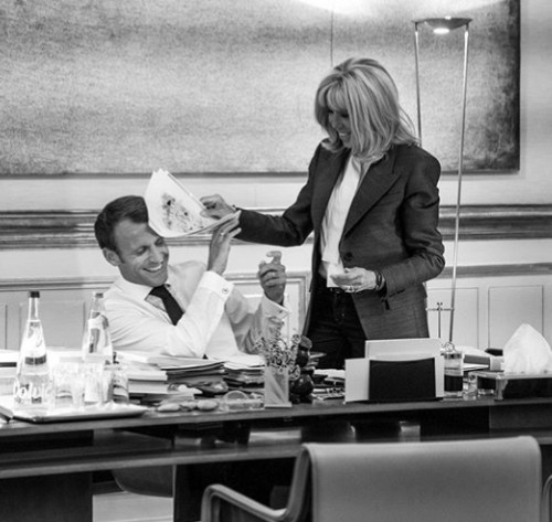Adorable photo of French President Emmanuel Macron and his wife Brigitte playing in his office