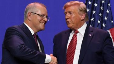Scott Morrison shakes Donald Trump's hand during a visit to a US factory opening as part of a state visit in September 2019
