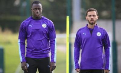 Manchester City players Benjamin Mendy (left) and Bernardo Silva (right) in training