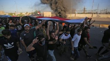Iraqi protesters take part in a demonstration against state corruption, failing public services, and unemployment, in the Iraqi capital Baghdad's central Khellani Square on October 4, 2019.