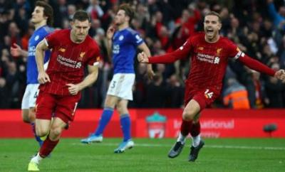 James Milner celebrates scoring the winner for Liverpool against Leicester