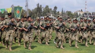 Syrian Kurdish People's Protection Units (YPG) militiamen at a parade in Qamishli on 28 March 2019