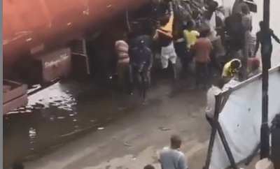 Nigerians spotted scooping fuel from a tanker that spilled its content in Lagos (video)