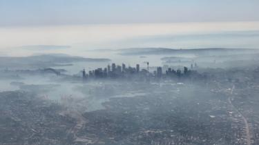 Aerial view of Sydney shrouded in smoke