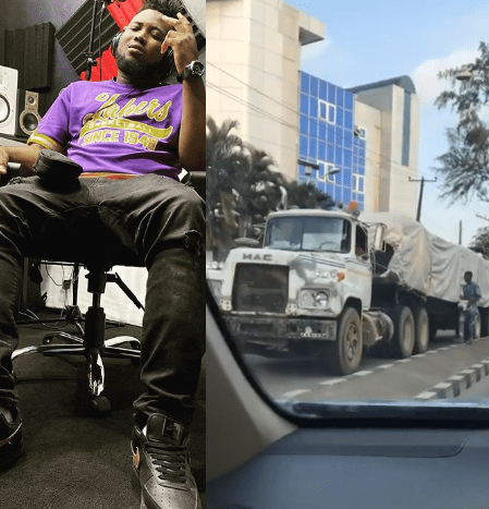 Chinko Ekun shares video of trailer without brake plying a busy road while a boy uses a huge stone to wedge the tyre at intervals