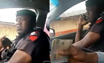 Bribe-taking policeman spotted lying to his colleagues about the amount he collected from a motorist (video)