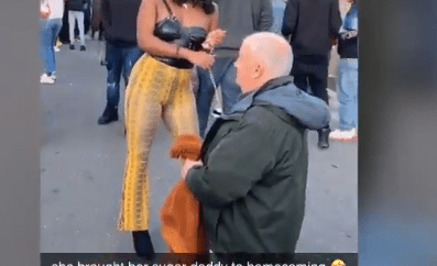 Student causes commotion as she brings an aged man on a leash to North Carolina Central University homecoming (video)
