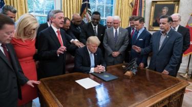 President Trump prays with faith leaders in the Oval Office