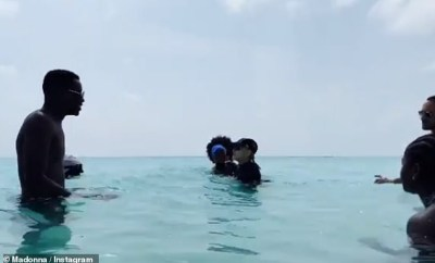 Madonna, 61, shares video of toyboy beau Ahlamalik Williams, 25, on holiday with her?children
