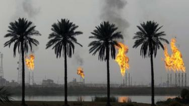 Flames rising from the burning of excess hydrocarbons at the Nahr Bin Omar natural gas field, north of the southern Iraqi port of Basra.