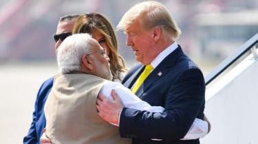 India's Prime Minister Narendra Modi (L) embraces US President Donald Trump upon his arrival at Sardar Vallabhbhai Patel International Airport in Ahmedabad on February 24, 2020.