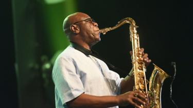 "Emmanuel N""Djoke Dibango, known as Manu Dibango performs during his concert at the Ivory Hotel Abidjan in 2018"