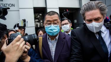 Hong Kong media tycoon and founder of Apple Daily newspaper Jimmy Lai (C) leaves the Kowloon City police station in Hong Kong on February 28, 2020,