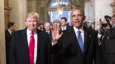 Former US President Barack Obama (R) with President Donald Trump