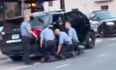 New video shows three Minneapolis officers kneeling on George Floyd before he died