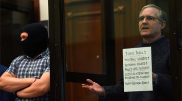 Paul Whelan, a former US marine accused of espionage and arrested in Russia in December 2018, stands inside a defendants 'cage as he waits to hear his verdict in Moscow on 15 June 2020